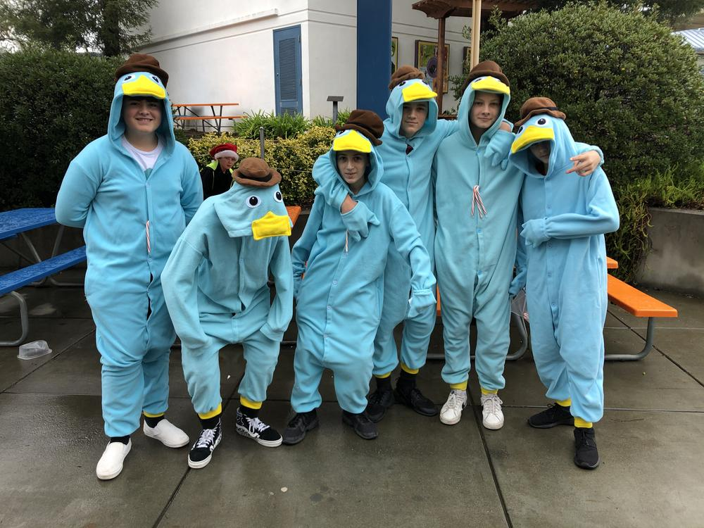 Students in pajama duck suits